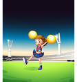 A pretty young cheerleader at the field vector image vector image