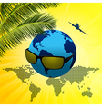 Planet Earth with sunglasses on summer background vector image vector image