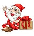 Santa sitting beside a gift vector image vector image