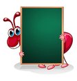 An ant holding an empty board vector image vector image
