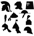 A set of silhouettes of medieval military helmets vector image