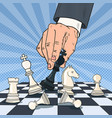 pop art hand of businessman playing chess vector image