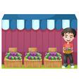 A boy selling grapes vector image