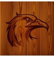 Eagle head vintage logo on realistic brown wood vector image