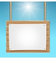 Hanging wooden blank sign board blue sky vector image