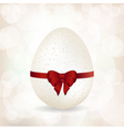 White speckled egg and red ribbon background vector image