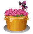 A basket of pink roses with a butterfly vector image vector image