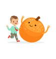 happy boy having fun with fresh smiling orange vector image