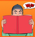pop art amazed man holding book vector image