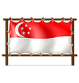 The flag of Singapore attached to the wooden frame vector image vector image