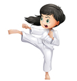 A young woman doing karate vector image