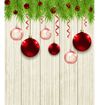 Green fir branches and red baubles vector image