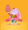 rabbit in clothes holding an easter egg in hand vector image