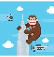 Gorilla on a top of skyscraper old school pixel vector image