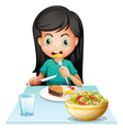 A girl eating her lunch vector image