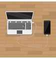 mobile phone charging from laptop usb port vector image
