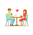 young happy couple in love sitting in cafe vector image