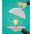 Hands holding platter cloche with idea light bulb vector image
