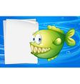 A green piranha beside an empty signboard vector image