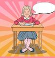 pop art schoolgirl sitting at school desk vector image