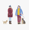 man and woman dressed in winter clothing standing vector image