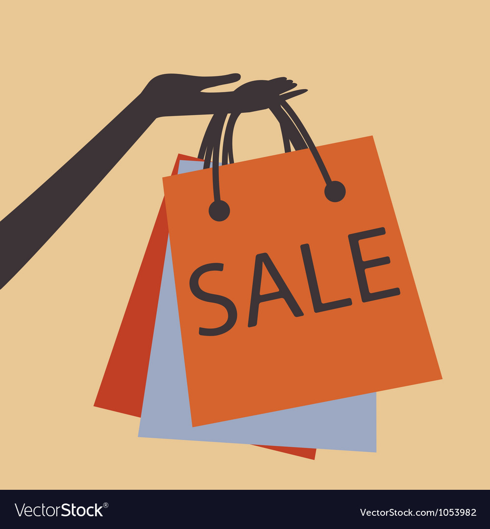Hand holding shopping bags vector