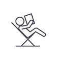 reading book sitting in chair linear icon sign vector image
