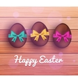 easter chocolate eggs on rustic wooden vector image