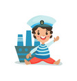 cute happy little boy in sailors costume sitting vector image