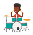 man playing on drum kit vector image