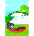 Woman lying in hammock vector image