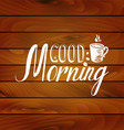 Good morning inscription on wooden background vector image