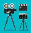 Movie and photo film cameras set on tripods vector image