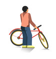 person stands and holds red bicycle isolated vector image