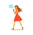 young woman walking and sending a message to vector image