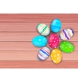 easter colored eggs on rustic wooden planks vector image