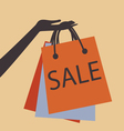 HAND HOLDING SHOPPING BAGS vector image