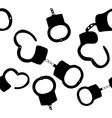 Seamless pattern of handcuffs silhouettes on vector image