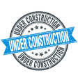 under construction blue round grunge vintage vector image