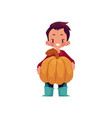 boy keeps big pumpkin isolated vector image