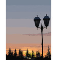 silhouette of street lights and trees at sunset vector image