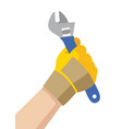hand with glove holding a wrench vector image