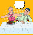 Couple having dinner in restaurant pop art vector image