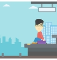 Man sitting on suitcase at the train station vector image