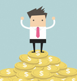 Businessman standing on gold coin vector image