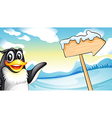 A penguin beside the wooden arrow signboard vector image vector image