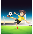 A boy in a yellow uniform playing soccer in the vector image vector image