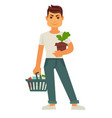 male person holds flowerpot and cart with products vector image