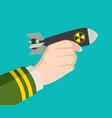 hand holding a rocket nuclear bomb vector image
