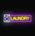 glowing neon laundry signboard on dark brick wall vector image
